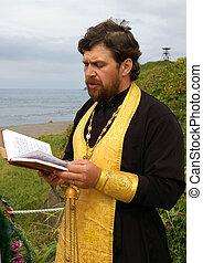 Orthodox priest moleben - The Orthodox priest reads public ...
