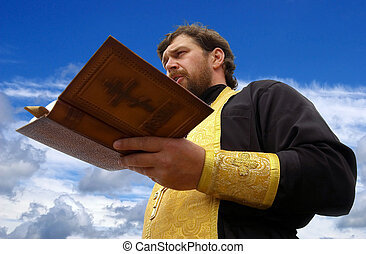 Orthodox priest reads public supplicatory prayers moleben
