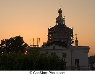 orthodox temple with sunset at background