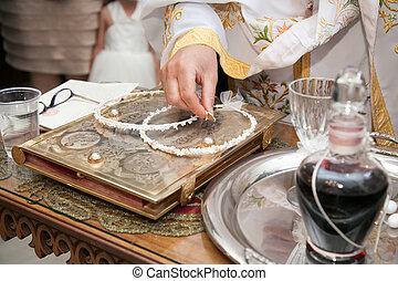 Orthodox wedding concept - Orthodox priest holding wedding...