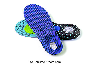 Orthopedic insoles for athletic shoes on a white background