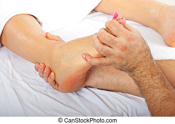 Orthopedic massage - Health care worker giving orthopedic...