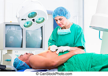 Orthopedic surgeon operating patient