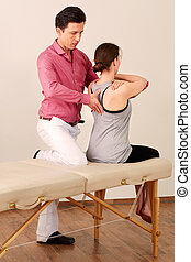 Orthopedic surgeon with a patient in treatment