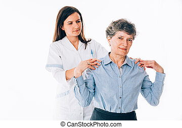 Orthopedist stretching patient shoulders