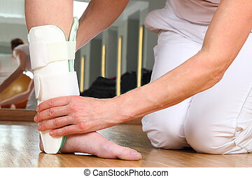 Orthopedist with Patient and Ankle orthosis - A Orthopedist...