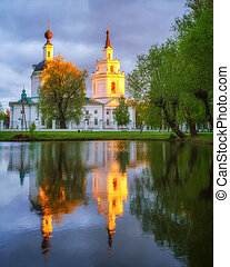 Russian ortodox church and its reflection in a pond. Boldino, Russia