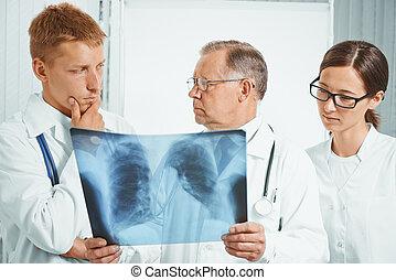 orvosok, megvizsgál, röntgensugár szobor