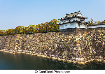 Osaka Castle along river in Japan