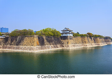 Osaka Castle wall at riverside in Japan