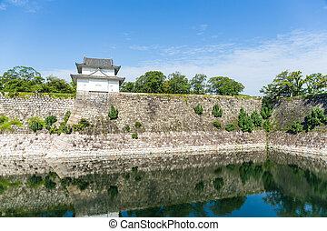 Osaka Castle wall at riverside in Japan
