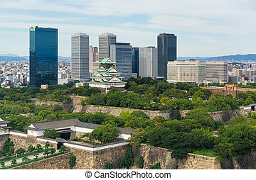 Osaka castle with business building