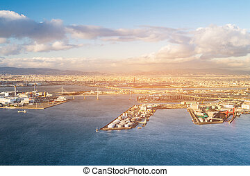Osaka city and seaport aerial view skyline background from Cosmo building, Japan