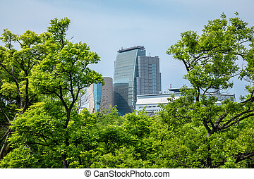 Osaka, Japan city skyline at the castle and business park in the