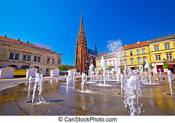 Osijek main square fountain and cathedral view, Slavonija region of Croatia