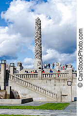 OSLO, NORWAY - MAY16: Visitors enjoying the statues created by Gustav Vigeland in the popular Vigeland park in Oslo, Norway on May 16, 2012
