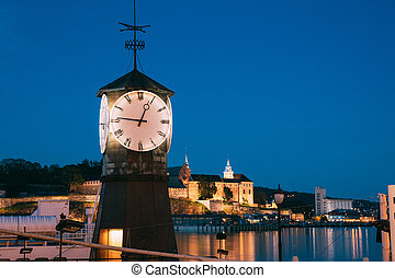 Oslo. Norway. Old Clock at Aker Brygge In Oslo Embankment, Norway. Night View Of Famous And Popular Place