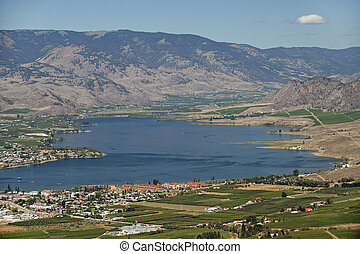 Osoyoos Lake with camp site and orchards