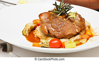 Veal shank roasted and served on braised vegetables