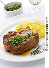 Ossobuco is a Milanese specialty of cross cut veal shanks braised with vegetables
