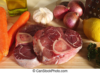 A collection of ingredients for Ossobuco (italian veal shank stew) on a chopping board.