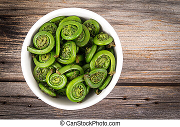 Ostrich Fern Fiddleheads bowl ready to cook with this seasonal ingredient