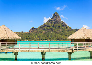 Otemanu mountain view and traditional overwater bungalow's with stunning lagoon at Bora-Bora, Tahiti, French Polynesia