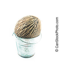 Othalanga in small bucket on white background, stock photo