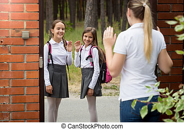 ?other seeing her two daughters off to school