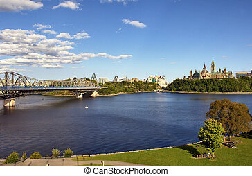 OTTAWA, CANADA – AUGUSTUS 8: Parliament Buildings and Fairmont Chateau Laurier Hotel in Ottawa .Wide-angle view of Parliament Hill and Ottawa River, Ontario, Canada