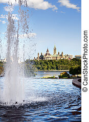 Ottawa cityscape in the day over river with historical architect