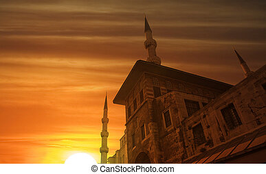 Sunset time viewed an old, historic building. Ottoman and istanbul dreams at down time.