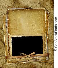 oud, pagina, met, frame, voor, photo., linten, en, bow.