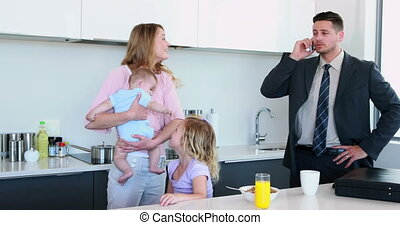 oung family having breakfast togeth - Young family having...