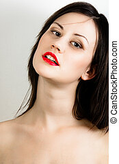 oung fashion model with white skin and red lipstick
