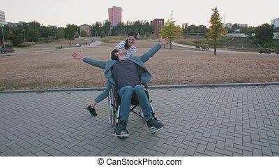 ?ouple having a fun, woman and man in wheelchair