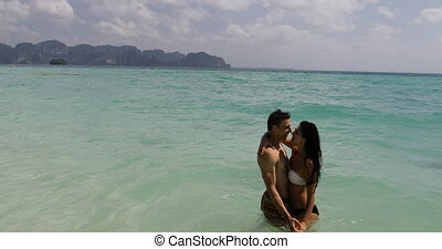 ?ouple In Water On Beach Kiss Embracing, Man And Woman In...