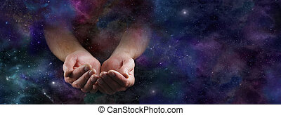 Male hands emerging from a wide dark deep space background gesturing with cupped hands