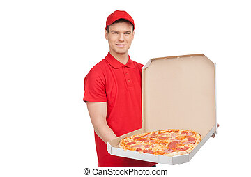 Our best pizza for you. Young cheerful pizza man holding an open pizza box and smiling while isolated on white