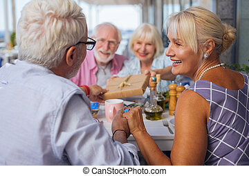 Joyful delighted woman looking at her husband