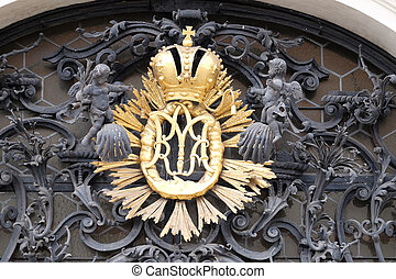 Our Lady monogram on the main entrance, Mariahilf church in ...