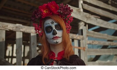 Portrait of our lady of holy death, santa muerte with sugar skull and colorful wreath standing near rustic shed outdoor, looking with cold stare, ready for safe delivery souls of deceased to afterlife