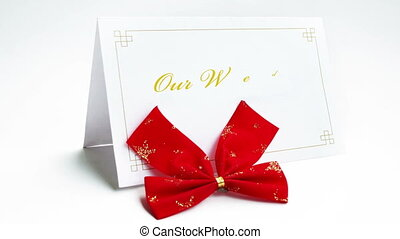 Our wedding text on greeting card with bow