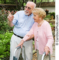 Out for a Stroll - Senior couple taking a walk outdoors...