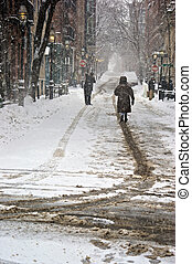 out in snow storm - heavy snowstorm in boston with people...
