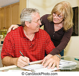 Out of Debt! - Mature couple happy about paying off their...