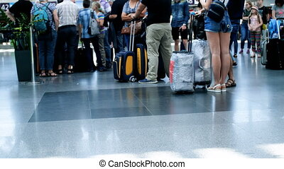 Out of focus 4k footage of people feet and luggage at...