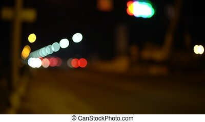 Out of focus city traffic at night in bright colors