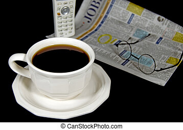 Out Of Work - Cup of coffee and newspaper with phone