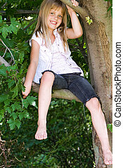 Out On A Limb - Little girl perched on a tree limb.